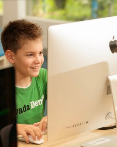 Kid using iMac